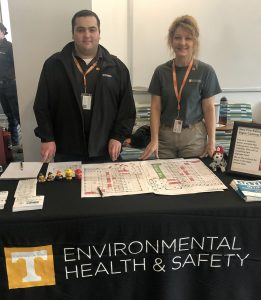 Pam Koontz and Ahmad standing behind a display table